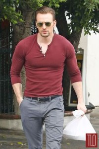 Chris Evans' henley shirt with slacks fit right in at any neighborhood bar.