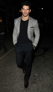 Model David Gandy's sweater and blazer are the perfect combo when sipping wine and champagne.