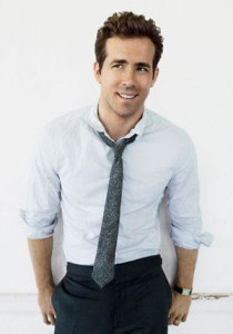Ryan Reynolds rolled up sleeves and skinny tie declares the 9 to 5 is over and the night is young.