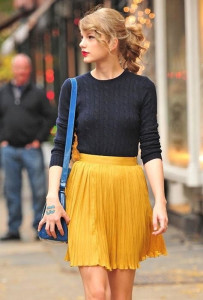 Taylor's yellow pleated skirt is the perfect outfit for sipping mimosas with friends during brunch.